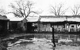 老照片:晚清北京城水災是啥樣?圖3即使大水漫膝也要出去做生意