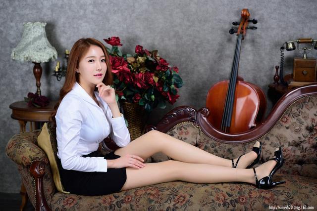 高貴典雅的女子,皮膚白皙,喜歡彈奏大提琴
