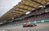 馬來西亞F1賽車大獎賽現場,法拉利賽車的賽車技師正辛苦工作中