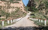 59年前7千農民手推肩挑,修建了一條盤山公路,如今人們已經忘記