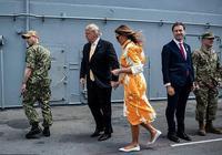 梅拉尼婭捨得穿平底鞋啦!配明亮黃色塗鴉裙好俏皮,衣品讓我服氣