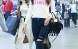 林志玲穿著白毛衣搭配黑色破洞牛仔褲現身機場
