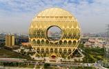實拍造價10億元的廣州圓大廈,酷似一枚大銅錢,被稱為土豪金大廈