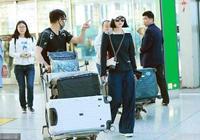 吳奇隆和劉詩詩現身機場,吳奇隆全程推行李十分寵愛妻子!