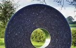 庭院裡的石頭成精了,私家花園也可用石頭做裝飾雕塑