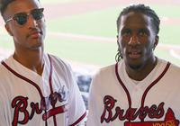 托裡恩-普林斯與約翰-科林斯觀看棒球比賽