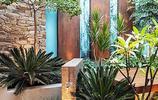 庭院設計:用碳化木做休息臺,用鵝卵石鋪設地面的庭院私家花園