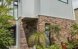 別墅設計:一個有紅磚外牆和鐵藝樓體的工業風現代簡約別墅設計