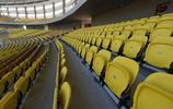 武漢卓爾足球俱樂部主場鋪設完新草坪,看臺座椅的主色調為黃色