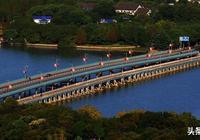 去無錫太湖黿頭渚風景區,過蠡湖,多要經過寶界橋,它是誰建的?