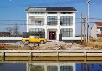 江蘇農村新中式別墅,小院帶陽光房,大空間很通透,建成後引圍觀