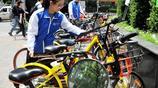 上海志願者街頭管理共享單車 無償服務將共享單車整理井井有條