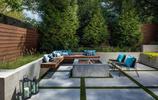 有三層私家花園的下沉式庭院,用石板鋪地、用防腐木作圍牆的庭院